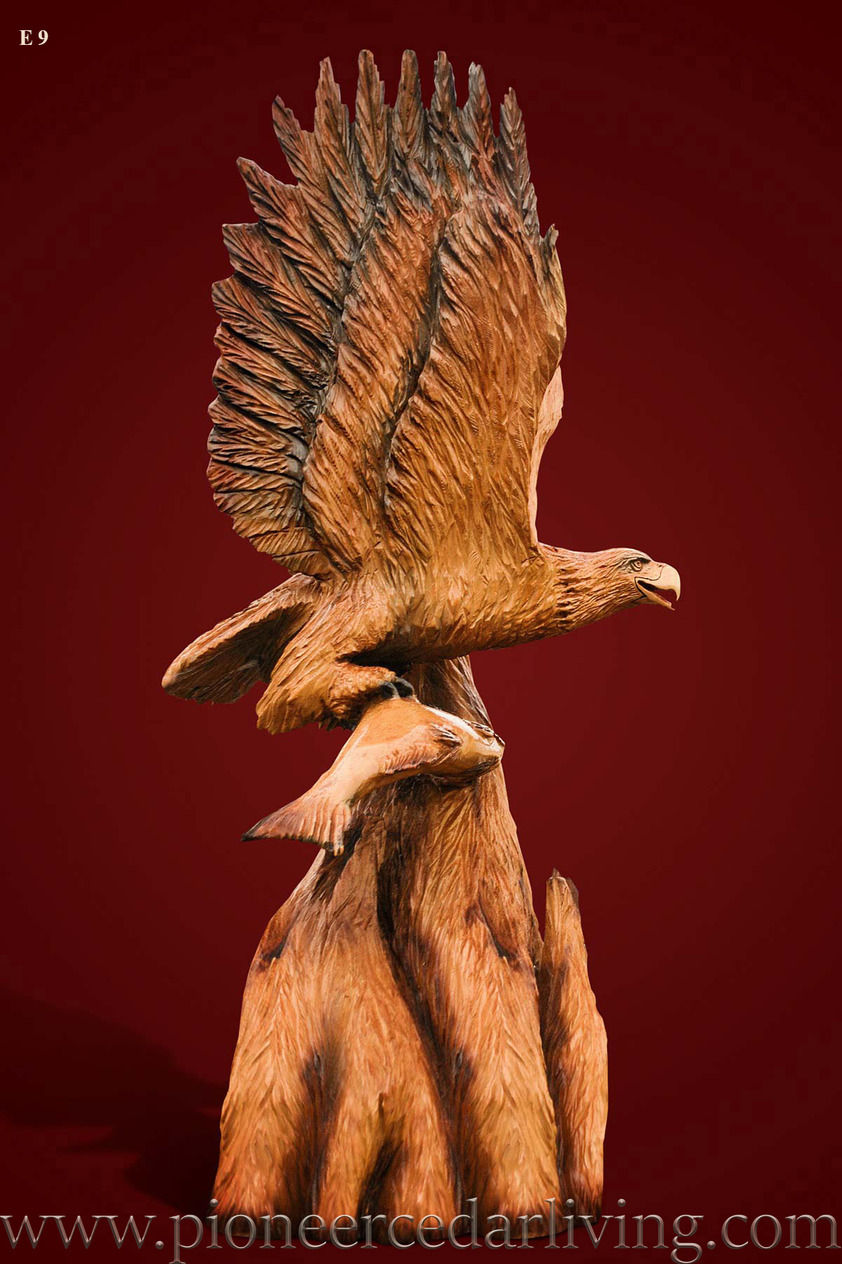 Custom chainsaw carving of flying eagle pioneer cedar living