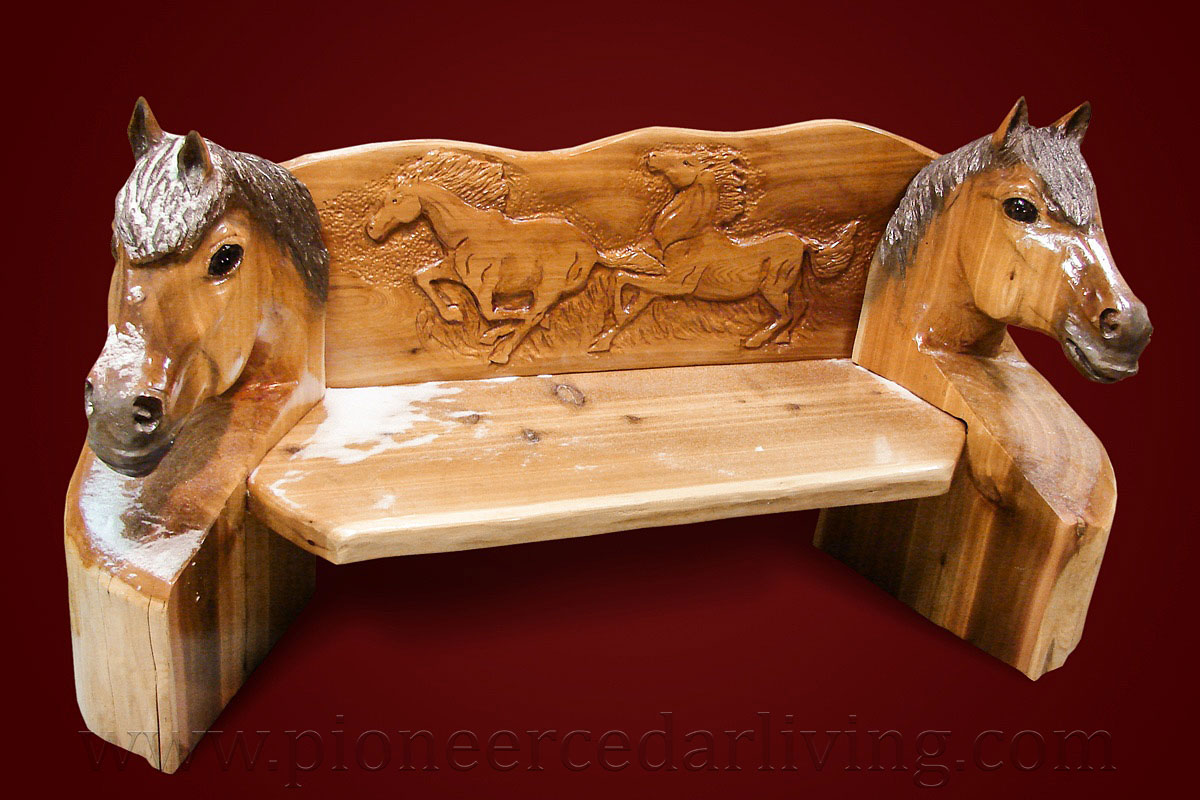 Custom wood bench with horse head chainsaw carving