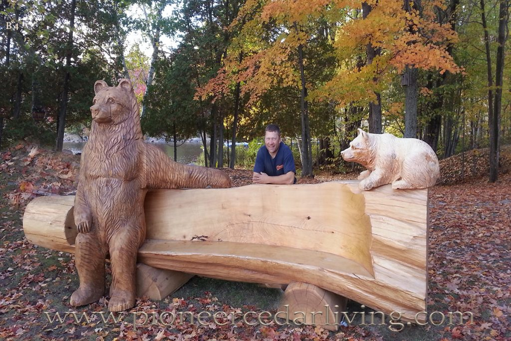 Bear chainsaw carving cedar log bench pioneer living