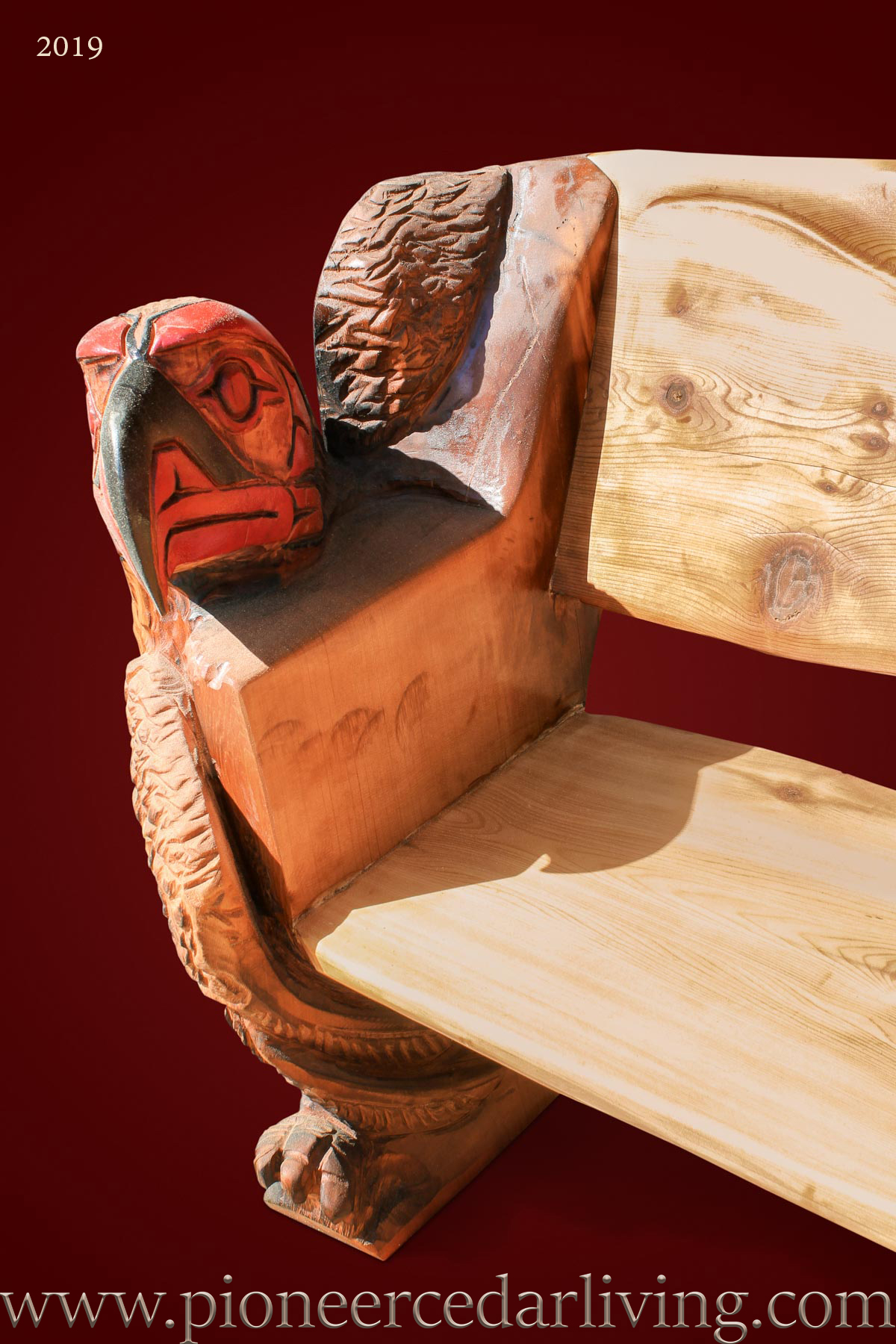 Western red cedar log bench with spirit eagle carvings
